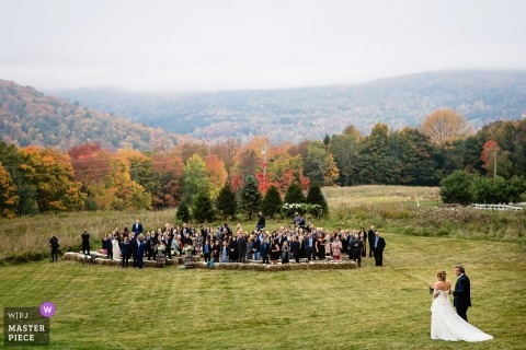 Warren, Vermont Wedding Reception Venue - Photograph of bride and father walking across lawn to ceremony