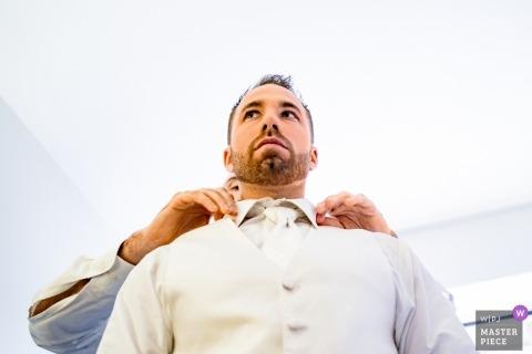 Chesapeake Bay Beach Club, Maryland wedding photograph of groom getting help with shirt collar over tie.