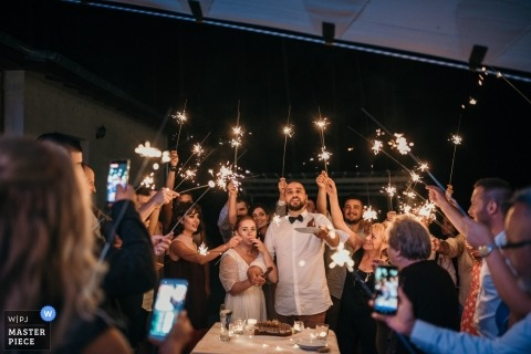 Picture of a couple surrounded by guests with sparklers by a top Lovech wedding photographer
