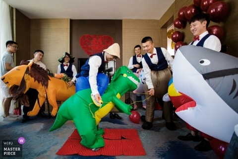 Wedding photojournalism at Fujian with groomsmen wearing costumes of sharks dinosaurs and lions