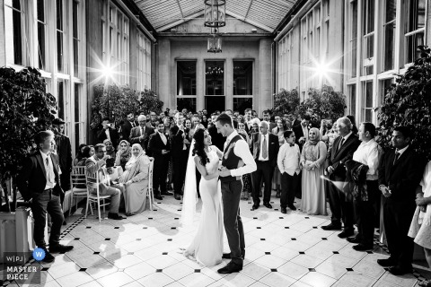 Stoke Rochford Hall, United Kingdom wedding reception photo of the bride and groom dancing.
