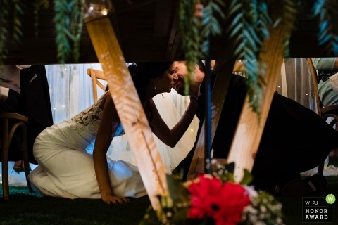Kiss under the table - Valencia Spain bride and groom during their reception