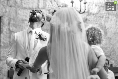 Orvieto wedding shoot with a groom looking to the sky as he attempts to recite his vows in the church