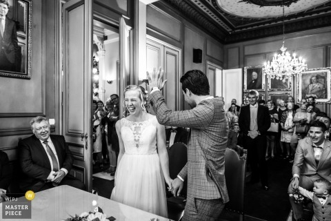 Noord Brabant groom shows his ring off to the guests during their wedding ceremony