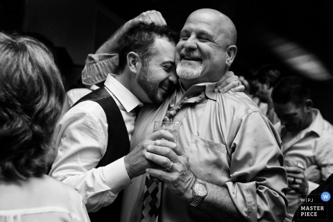 Groom hugging relatives at wedding ceremony in South Lake Tahoe, Nevada