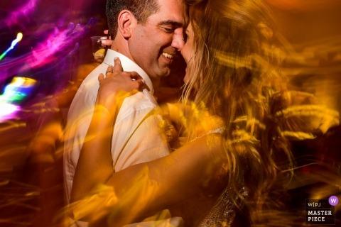 Campinas ślubny fotoreportaż obraz pary - powolna migawka wolno tańczy na przyjęciu