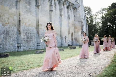 France documentary wedding photo of Ceremony with bridesmaids walking down gravel path