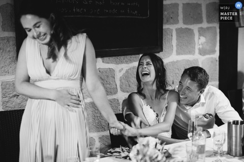 Primorje-Gorski Kotar county Wedding Photograph with a couple laughing during bridesmaid speech