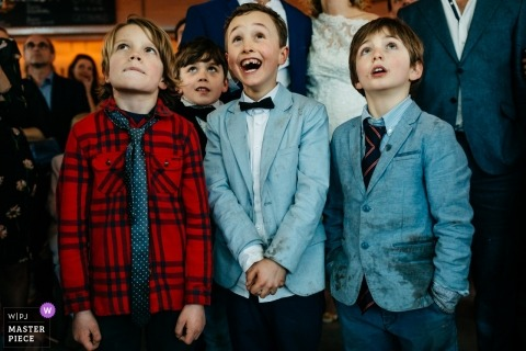 Utrecht wedding photo | wedding photograph of three young boys dressed up watching something overhead at this reception