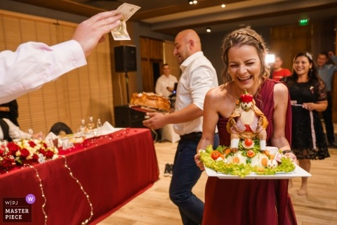 Documentary wedding photography at Borovetz reception | The wedding game with a Chicken