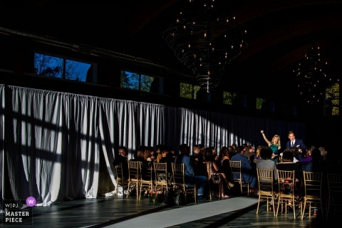 New Jersey wedding photograph -  Parents cheer at end of indoor lodge at stirling ridge stone house nj wedding