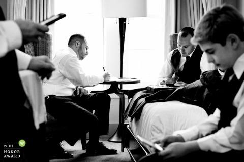 Wedding photo of men gettting ready before ceremony at Chesapeake Bay Beach Club, Maryland