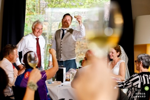 Barchem wedding shoot with a couple and toasting guests during speeches