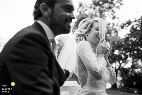 Lyon wedding photojournalism image of a couple laughing together outside - Best french wedding photographer