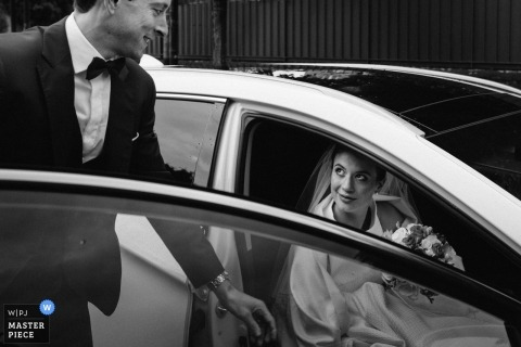 Le Chesnay groom helping his bride out of the car during their wedding