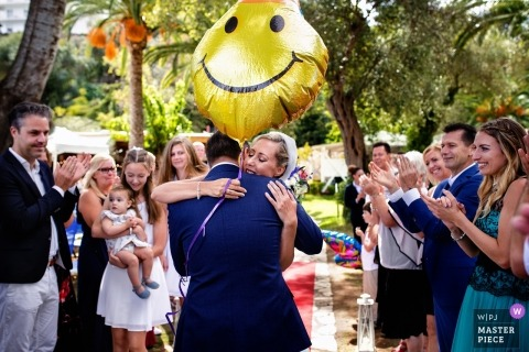 Athens wedding shoot with a couple hugging under happy face balloon