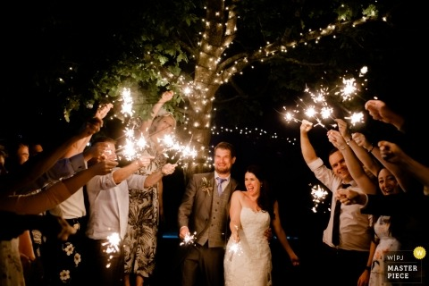 England couple under sparklers during their Curradine Barn wedding