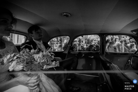 Wedding photojournalism from the limo backseat - bride and groom travel in Zuid Holland