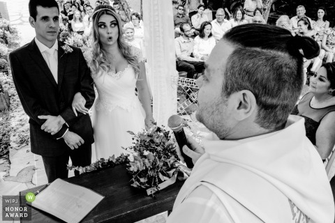 São Paulo wedding photojournalism image of a couple at the altar during their wedding ceremony vow exchange