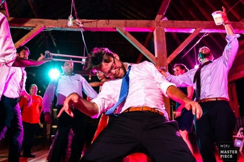 Sparta, Wisconsin wedding photograph from the rowdy dance floor with pink lighting