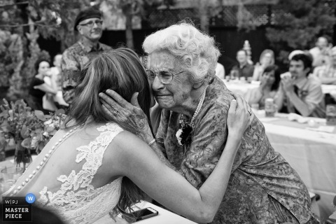 Wedding picture of elderly woman hugging bride by Reno, Nevada USA photographer