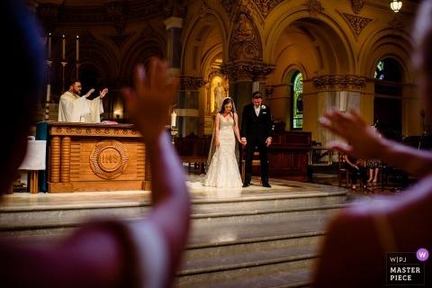 Photo of the ceremony prayer at St. Francis Xavier Church, NY.
