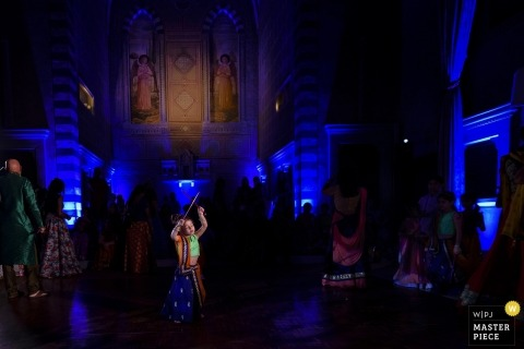 Florence wedding dance photo | wedding photograph of Kid dancing during Indian Wedding Party