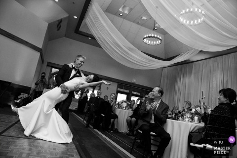 Picture of a NV couple dipping on the dance floor by a top Lake Tahoe wedding photographer