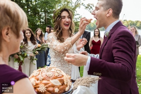 Ontario, Canada couple feed each other during their wedding ceremony outside