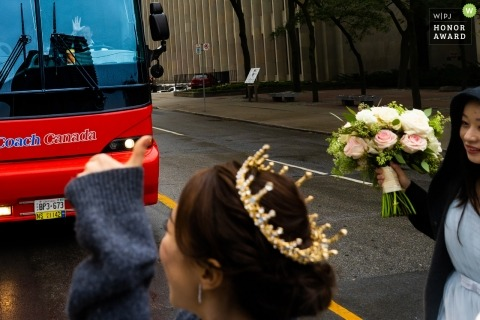 Crossing the road before red bus | documentary wedding photo at The University of Toronto