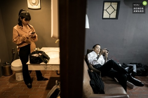 Documentary wedding photograph of getting ready down time at a Bangkok, Thailand wedding