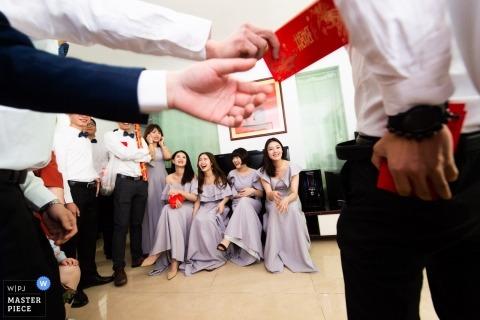 Zdjęcia ślubne tradycyjnych gier autorstwa fotografa Guangdong