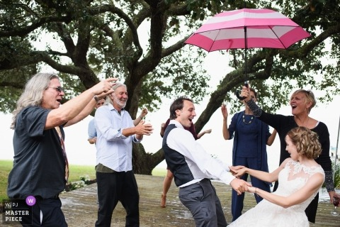 Rainy First Dance with umbrellas | Currituck, NC, USA
