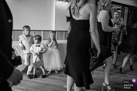 Baltimore documentary wedding photo of kids and women at the reception venue