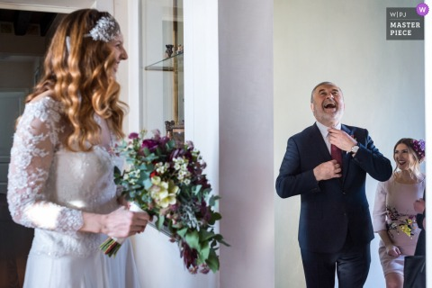 Wedding picture of a father laughing with his daughter the bride by Venice photographer
