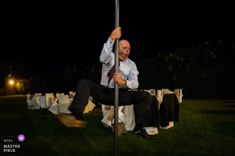 Castello Marchione Puglia Italy wedding photo of a pole dancing guest at the reception.