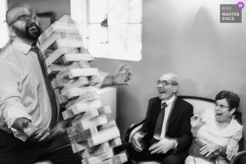 Wedding picture by Coopersburg, PA photographer of guests reacting to a wooden block Jenga Tower falling over