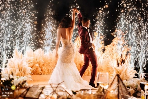 Pictures of a couple dancing it before a shower of fireworks by a top Phuket wedding photographer