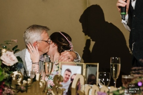 Lancashire documentary wedding photo from reception speech - couple kissing with shadows