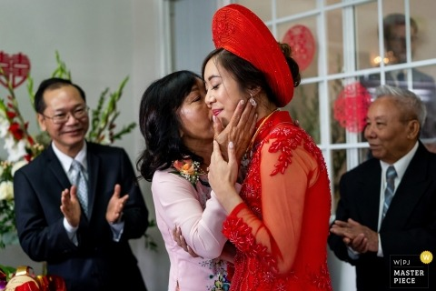 Anaheim, California wedding photo of mom kissing bride | CA wedding photography