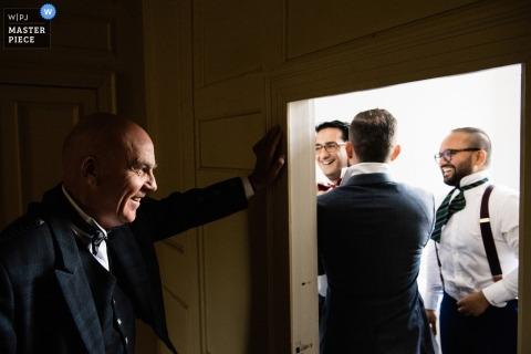Wedding photo shoot with groom and groomsmen in Neidpath Castle, Peebles, Scotland