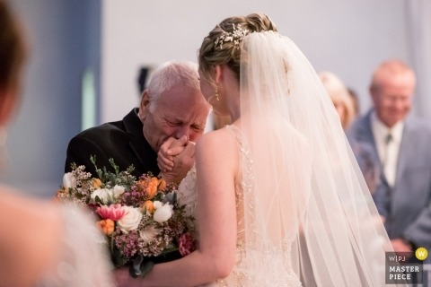 Father giving bride away with kiss - Crystal Room in Butler, PA wedding photography