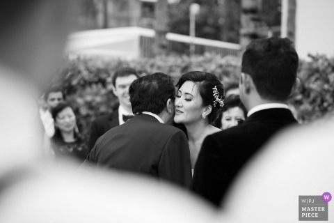 Miami documentary wedding photo of bride getting kissed by her father during her ceremony