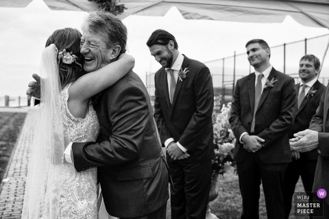 Nantucket, Massachusetts wedding photo | wedding photograph of bride getting hug during ceremony