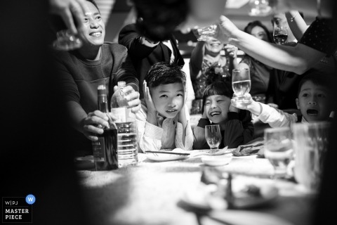 Malaysia Documentary wedding photography at Malacca with kids at table