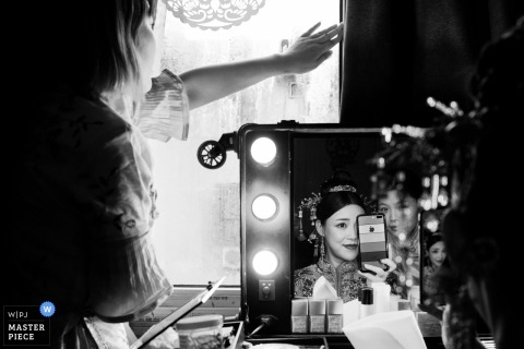 Wedding photo shoot with bride prep in mirrors in Zhejiang