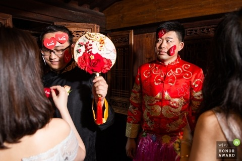 Beijing groom during their wedding door games in China for the bride