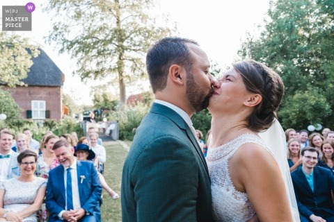 Netherland Documentary wedding photography of couple kissing during ceremony at Zuid Holland