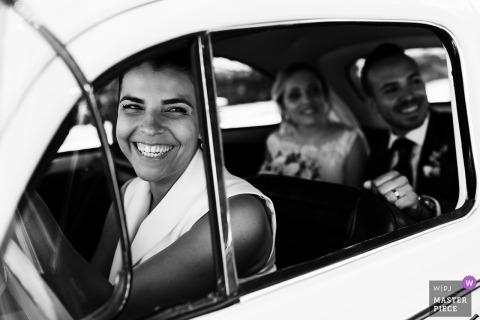 Wedding shoot with Fafe, Portugal couple in the back of a car with guest driving