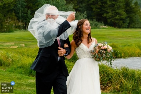 Vail Wedding Photographer | Veil troubles for this bride and her dad